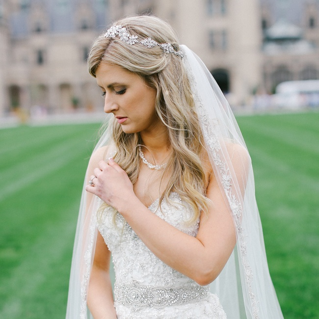 Rebekah accessorized her Sophia Moncelli gown with a subtle necklace,  gorgeous headpiece and a beaded, cathedral-length veil from Kleinfeld bridal salon in Manhattan. Her beauty look was provided by Too Faced Cosmetics and DryBar.