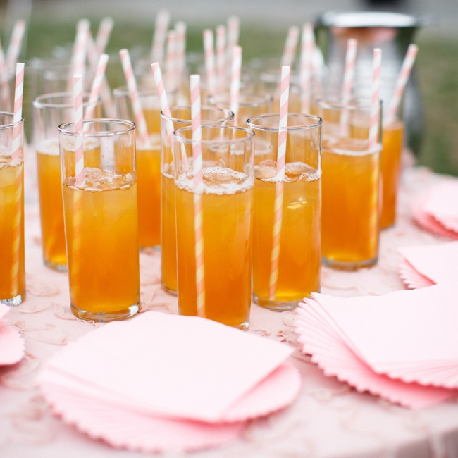 Before the ceremony, guests were served refreshing Arnold Palmers with striped straws and pink personalized napkins from The Knot Shop.