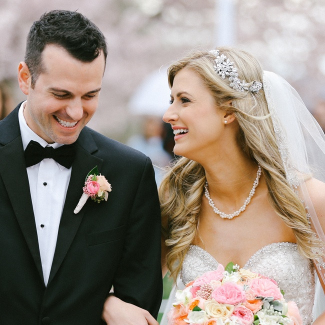 The couple shared a smiling trip back up the aisle as husband and wife.