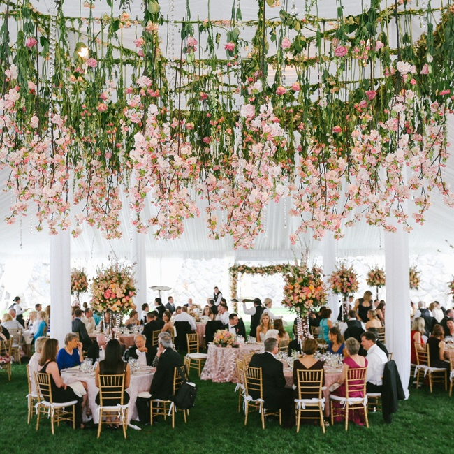 Decorations in the reception tent mirrored the beauty of the Biltmore Estate by mimicking the cherry blossom trees and hanging their pink branches from the tented ceiling. Flowers for the Dream Wedding were provided by American Grown and the California Cut Flower Commission and designed by Holly Heider Chapple Flowers.