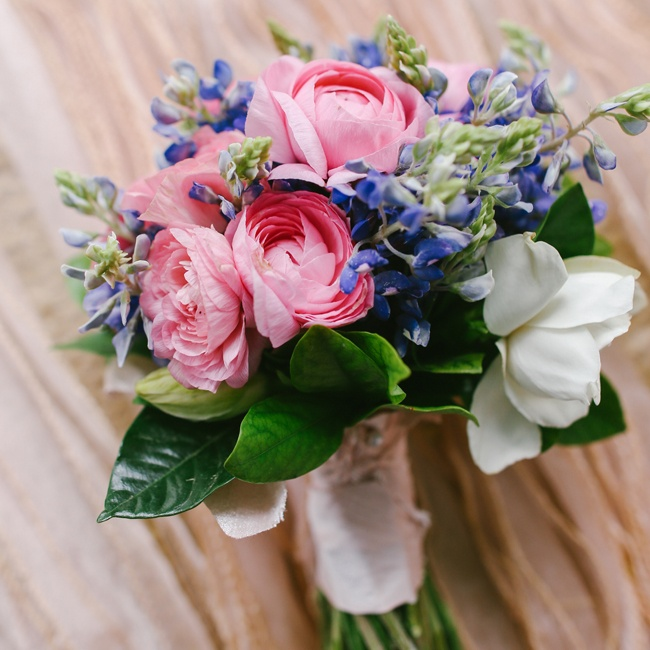 Rebekah's toss bouquet included pink ranunculuses and and purple stock. Flowers for the Dream Wedding were provided by American Grown and the California Cut Flower Commission and designed by Holly Heider Chapple Flowers.