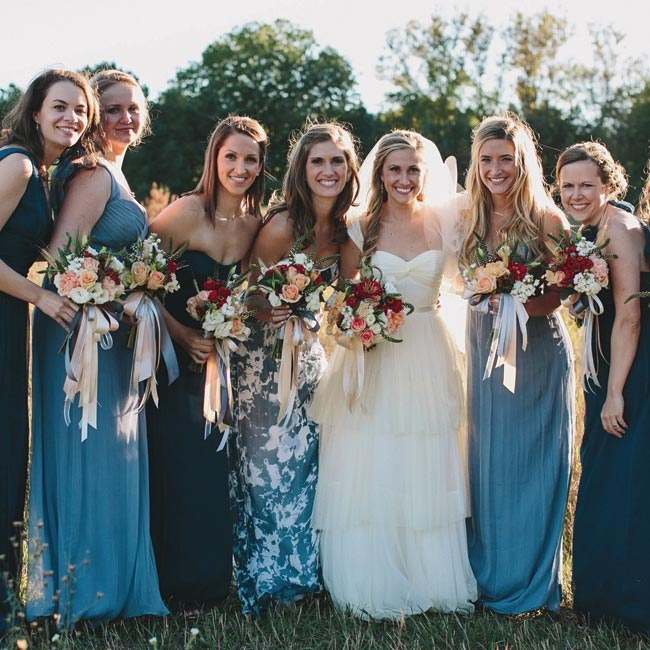 The bridesmaids wore dresses made by Amsale in a variety of styles, each in a shade of navy or slate. Katie's maid of honor also wore an Amsale dress in a blue floral print.