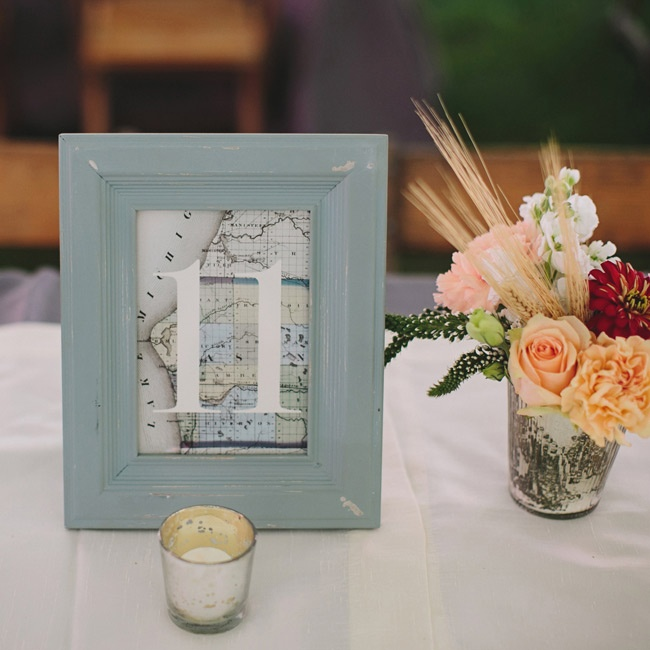 Pale blue frames displayed the table numbers, which were printed on maps of Michigan.