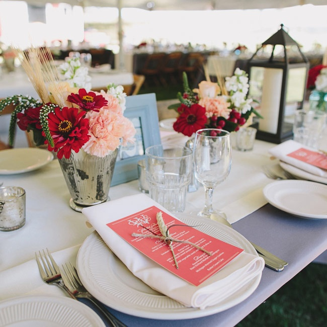 Coral colored menu cards added a pop of color to the white place settings, while small stalks of wheat tied into the rustic chic theme.