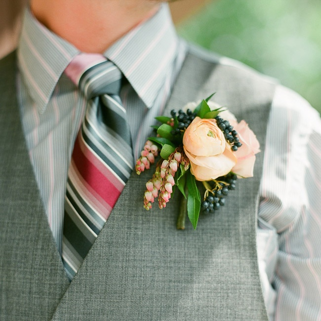 The groom completed his casual look with a striped shirt and a colorful, striped tie.