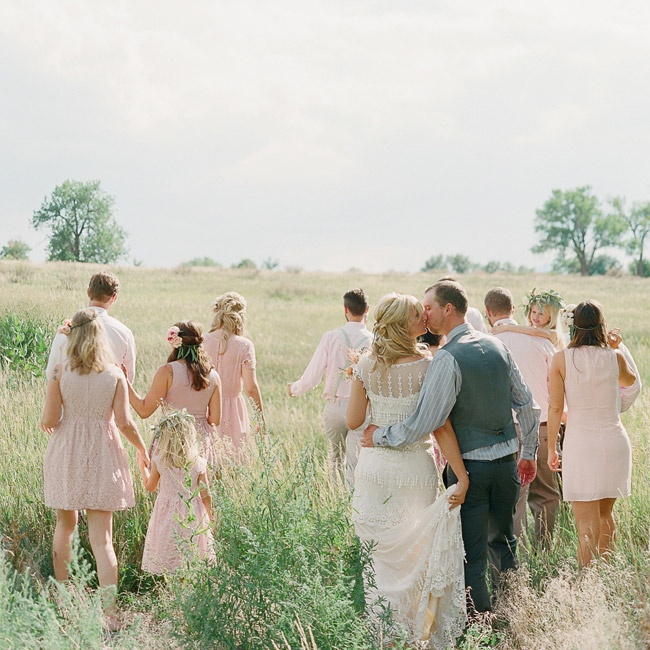 On the whole, the wedding party was neutral with light groomsmens pants and blush-colored bridesmaid dresses.