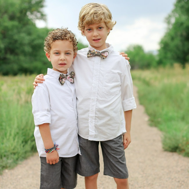 Ring bearers sported casual button down shirts with gray shorts and matching printed bowties.