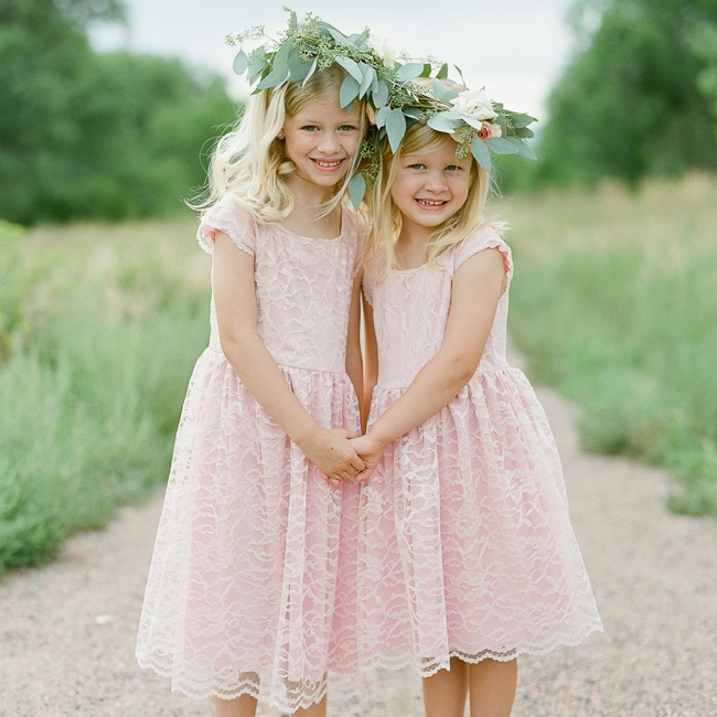 Flower girls were sweet in blush dresses with cap sleeves and lace overlays. Each girl donned a flower crown with eucalyptus leaves.