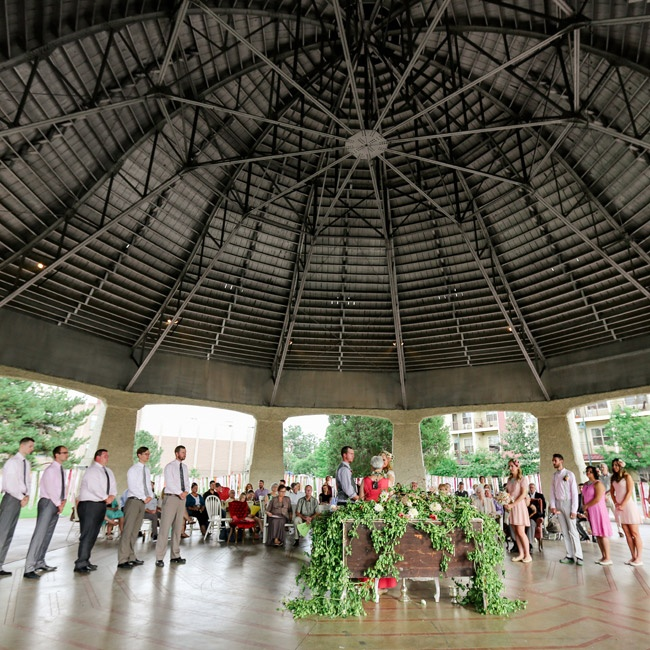The couple exchanged vows beneath a dramatic pavilion in Denver, Colorado.