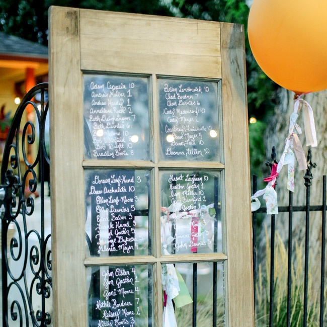 The couple repurposed a glass door to write out guests' seating assignments.