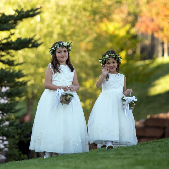 Christina's flower girls wore these classic sleeveless dresses and matching flower crowns.