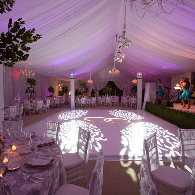 In the middle of the reception tent, there was a large white dance floor lit with special lighting.
