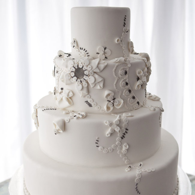 Christina and Cory's wedding cake had four tiers and mimicked the floral appliques in her Carolina Herrera wedding gown.