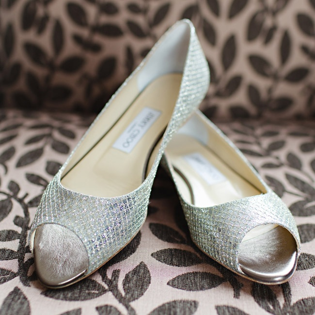 Erin walked down the aisle in comfort and style in these metallic, peep-toe Jimmy Choo flats.