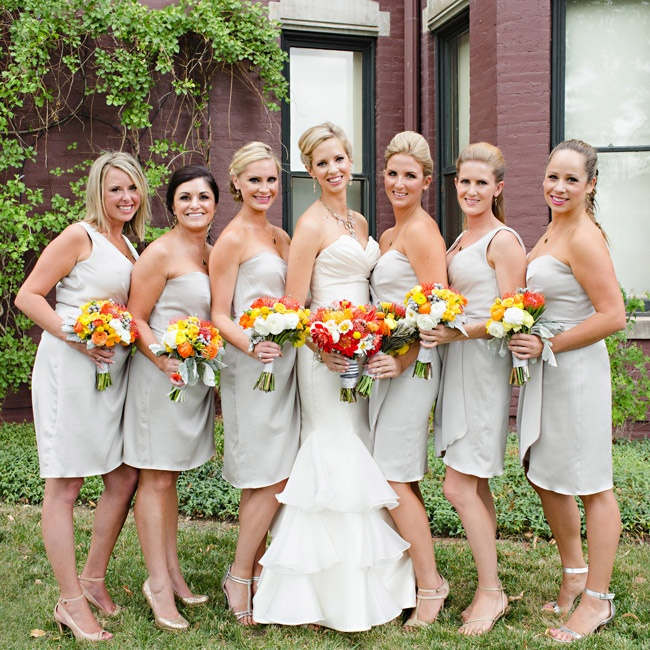 Since the event's details were full of bold color, Erin's bridesmaids stayed neutral in short dresses.