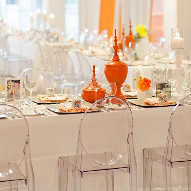 "With more subtle background decorations of lucite ""ghost"" chairs, white linens and see-through glasswear, the more whimsical, bright centerpieces made a statement."
