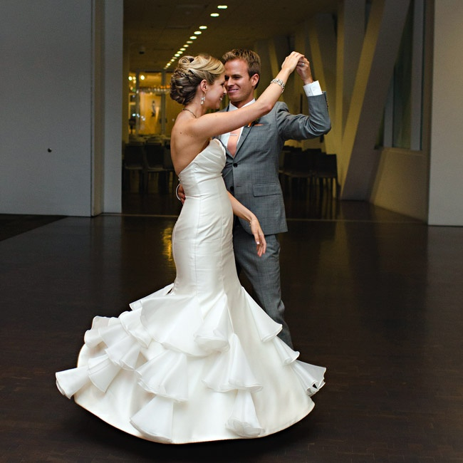 The bride wowed in her Tara Keely strapless gown accented with a tiered, fluted skirt.