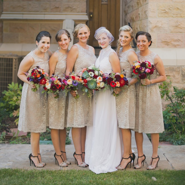 Bridesmaids stayed neutral in nude dresses with a white lace overlay and fun black and tan T-strap heels.