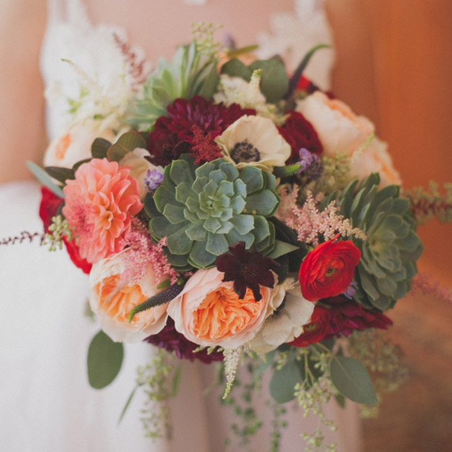 Lauren's statement-making red, peach, pink and green bridal bouquet was full of peonies, roses, dahlias and succulents.