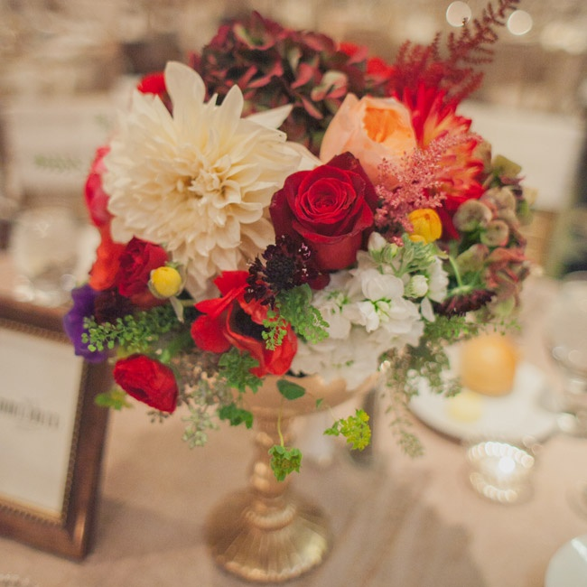 Centerpieces at the reception mimicked the bride's textured red and orange bouquet.