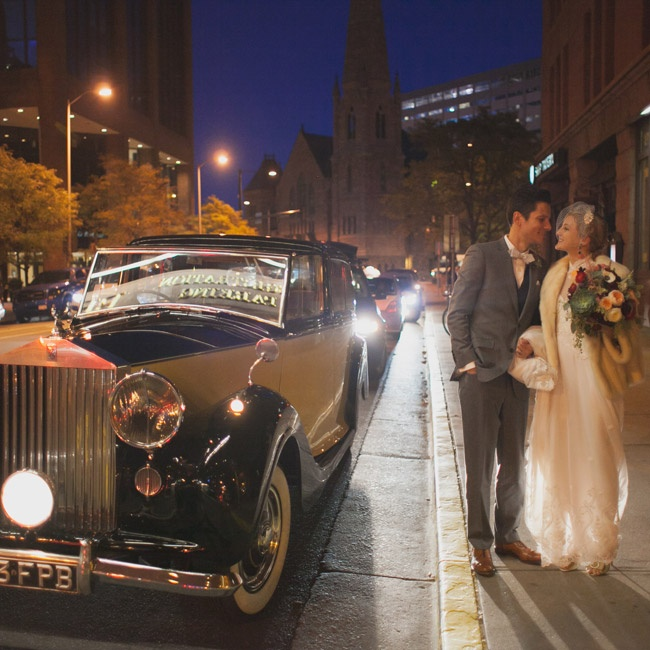 The couple left the reception in this stylish, vintage, two-toned  automobile.