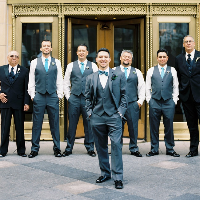 Groomsmen sported charcoal vests and slacks while the groom donned a full, three-piece suit with a blue bowtie.