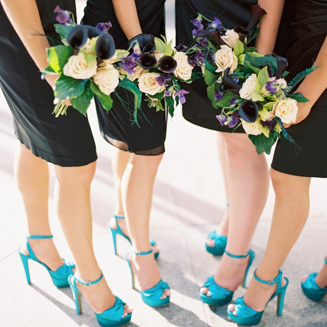 Rhiannon's bridesmaids wore short black dresses and accessorized with bright blue heels.