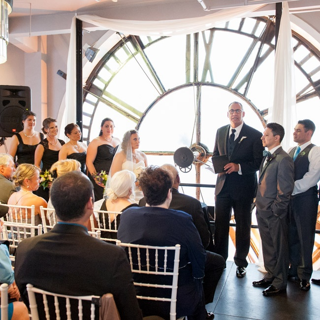 The couple exchanged vows at the Clock Tower in Denver, Colorado, surrounded by the huge faces of a ticking clock.