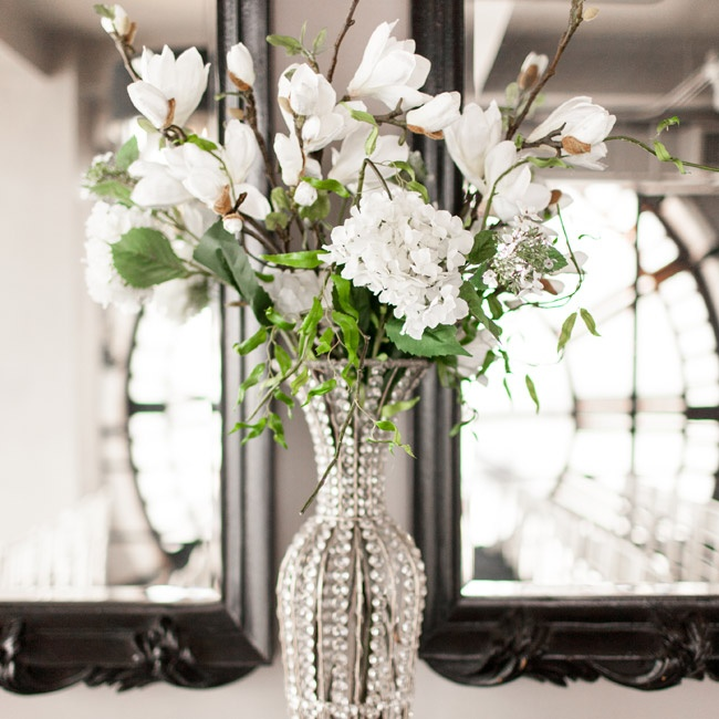 Elegant white florals filled crystal vases at the reception.