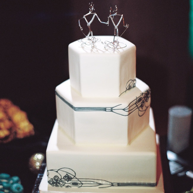 The couple's angular cake featured the same design motif as the save-the-date cards and ceremony programs.