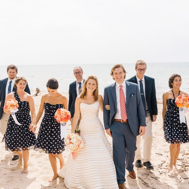 Complementing the polka dot, stripe and all around nautical theme, the bridesmaids wore short navy chiffon dresses with white polka dots. The guys wore khakis and navy blazers with crisp white shirts.