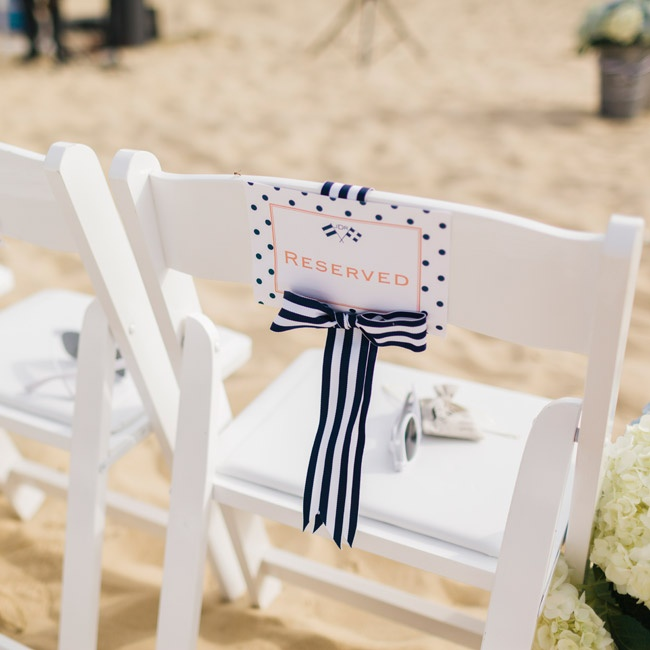 Reserved seats were marked with polka dot signs and navy and white striped ribbons. At each seat, Jamie and Ryan placed a pair of white sunglasses and a sachet of lavender.