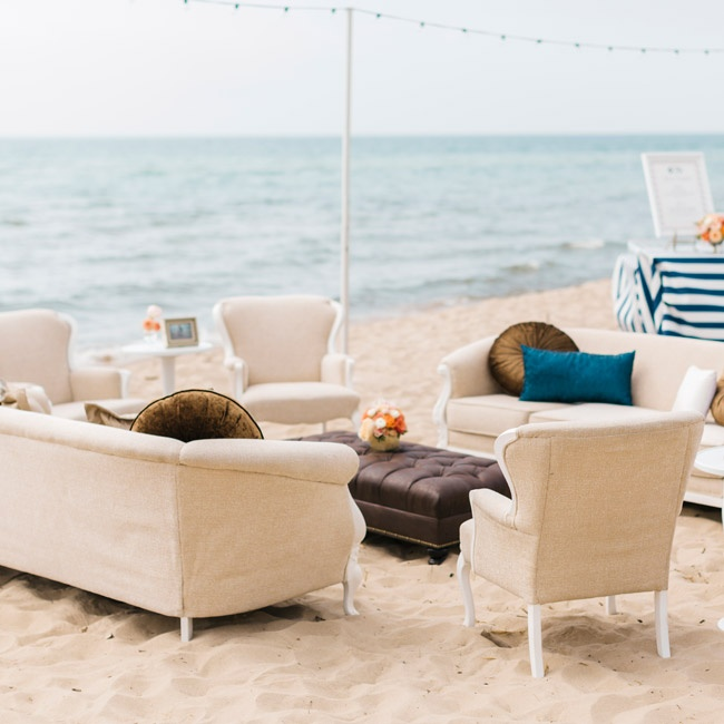 The couple set up a formal lounge area, complete with woven chenille couches, white end tables and framed photographs, on the sand - just mere steps from the water.