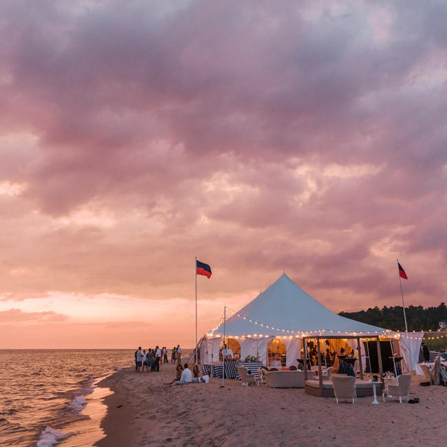 The reception was held under a large white tent right along the water's edge.