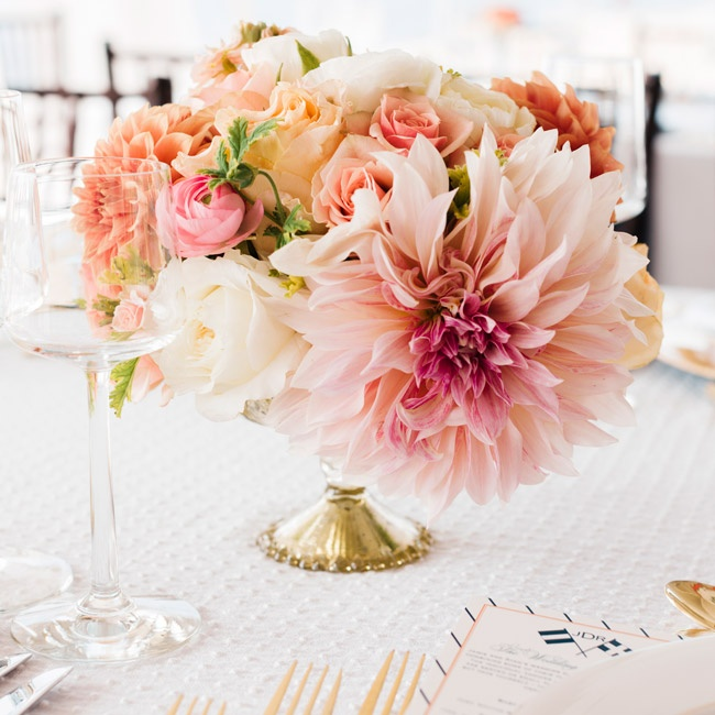The tables were decorated with small bouquets of peach, pink and ivory flowers like dahlias, roses and ranunculuses arranged in gold mercury glass vases.