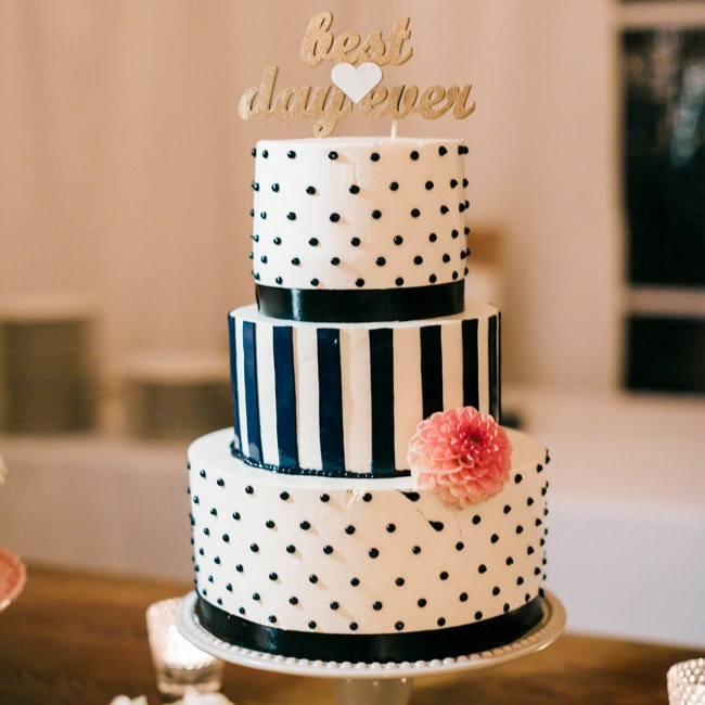 "In addition to a full dessert bar, the couple had a small, three-tiered wedding cake with navy stripes and a Swiss dot pattern. A single pick dahlia and ""best day ever"" cake topper added fun, playful touches."
