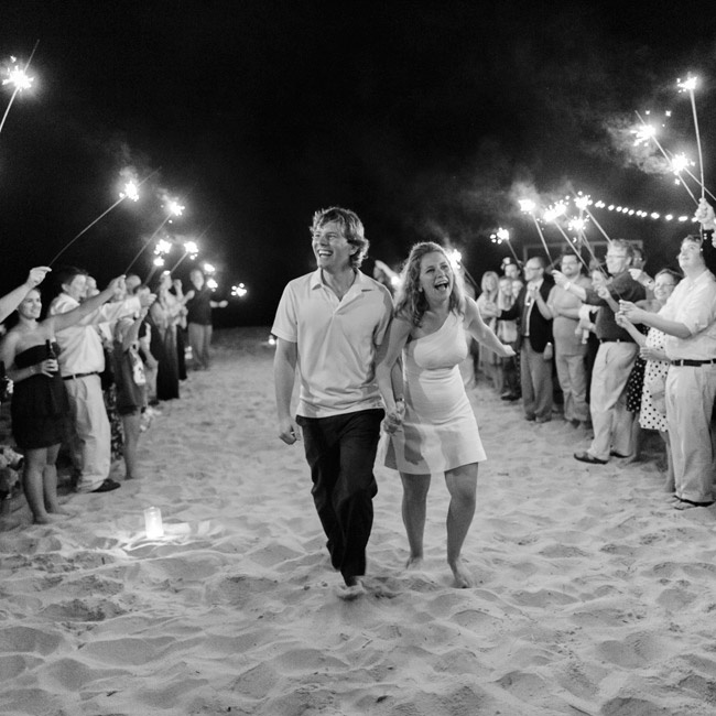 The couple made their exit through a lane of sparklers before driving off in a golf cart.