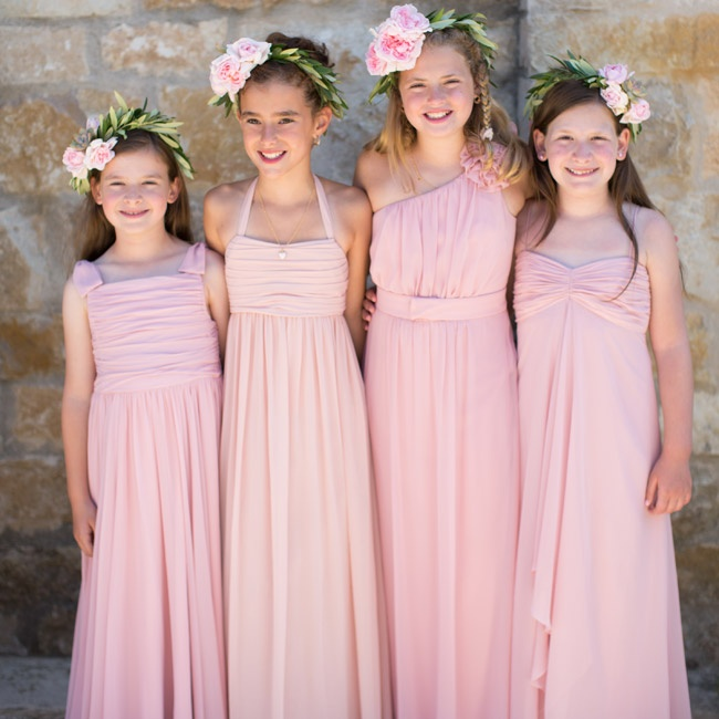 Rachel's flower girls wore floor-length blush-colored gowns and floral wreaths in their hair. Instead of petals, they threw rosemary, sage and thyme as they walked down the aisle.