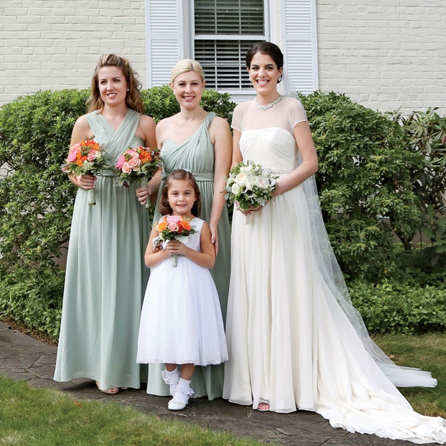 "Each bridesmaid wore a Jenny Yoo ""Aiden"" gown but tied the tops differently to achieve their own unique looks.  The pistachio color matched the neutral green used throughout all of the wedding's printed materials."