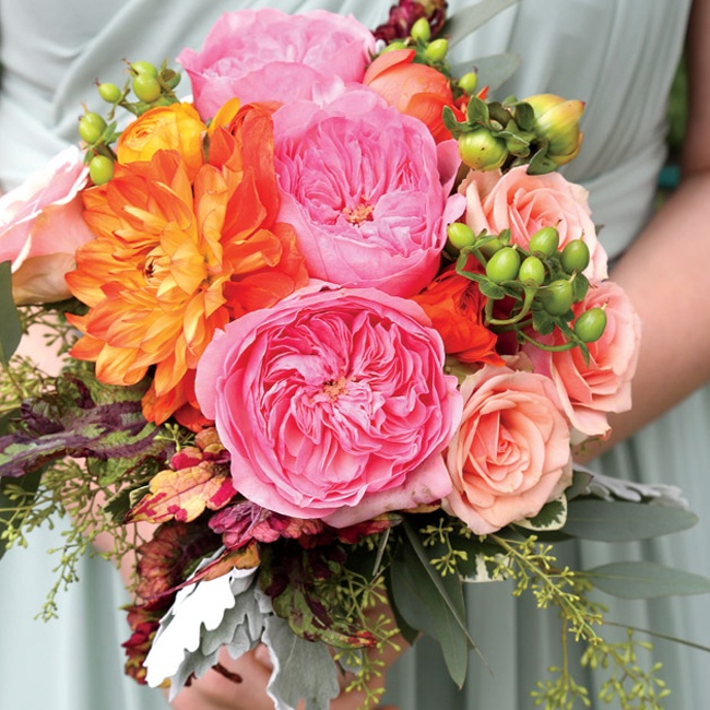 "The bridesmaids carried colorful bouquets of David Austin garden roses, dahlias, ranunculus, green Hypericum berries, seeded eucalyptus, dusty miller and coleus (which came directly from the florist's garden). ""I wanted them to be colorful and look like they were just picked from the garden,"" says Megan."