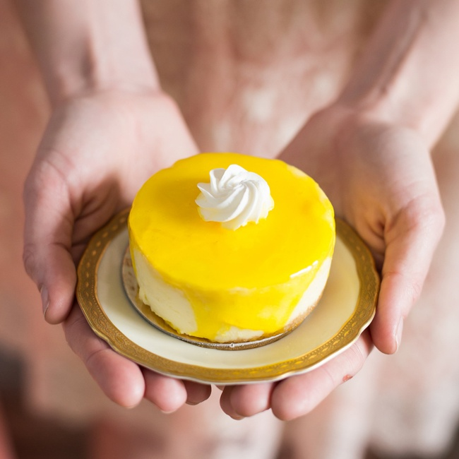 Individual cheesecakes were given a fresh pop of color with lemon glazing.