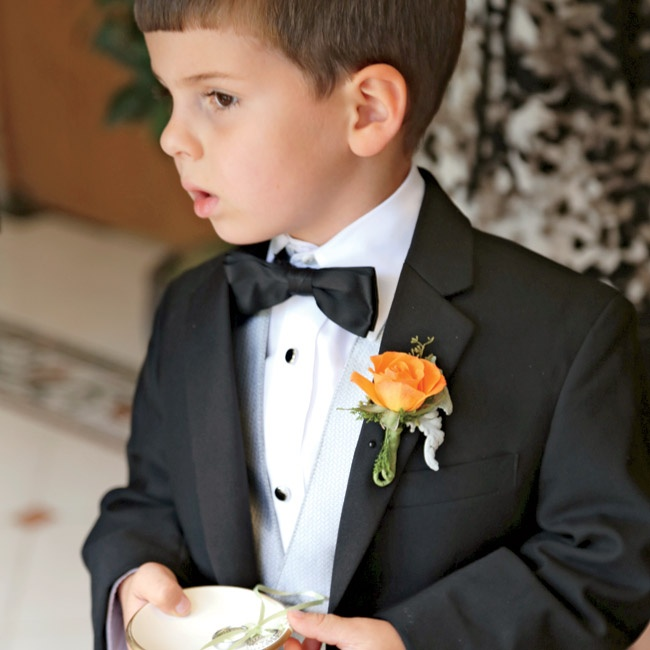 The bride's nephew, Jack, wore a classic black tux from Jos A. Bank and carried a personalized ring bearer bowl with a sage green ribbon.