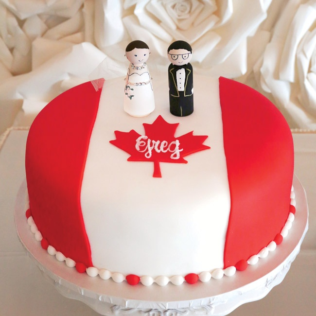 """As a surprise I ordered Greg a groom's cake that was carrot cake and decorated with the Canadian flag (which is where he is from),"" says Megan. ""We put the cake toppers I made on the groom's cake and they actually looked quite a bit like us—the bride even had a piece of my mother's veil!"""