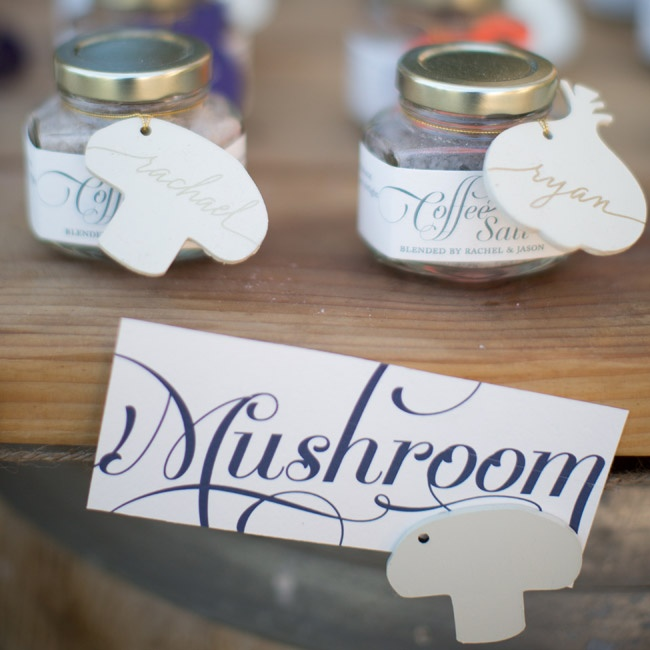 "In keeping with their farmers market theme, the couple named each reception table after a different type of produce (like mushroom, asparagus and tomato) and incorporated fresh ""examples"" throughout the tablescapes."