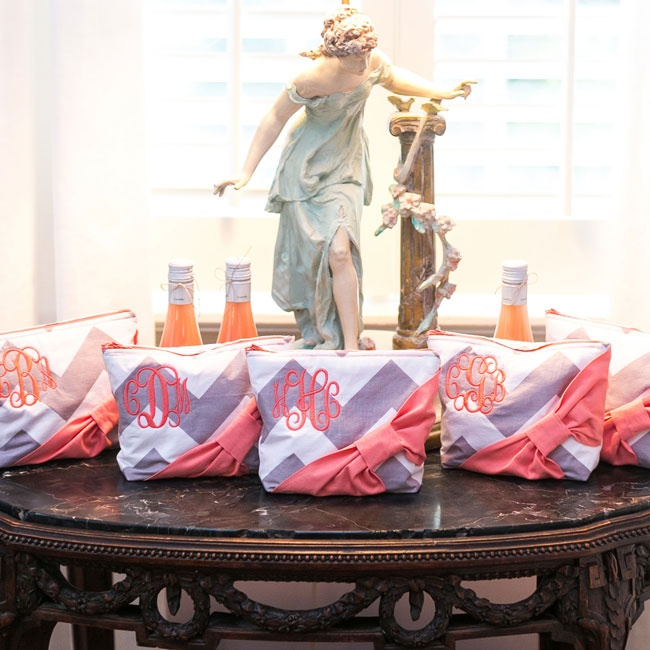 Lauren gave each of her bridesmaids monogrammed makeup bags with purple chevron and pink bows as a thank you gift.