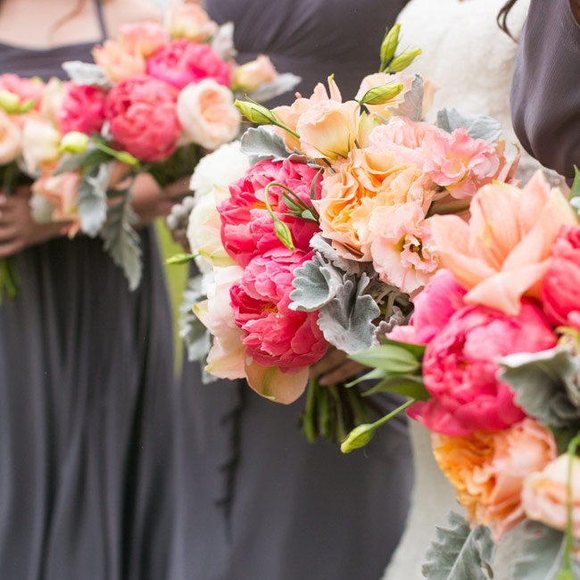 Bright pink and peach peonies, lilies and roses filled the bridesmaids' bouquets. The bouquets were accented with cool, sage-colored lamb's ear and had a fresh, cheerful feel.