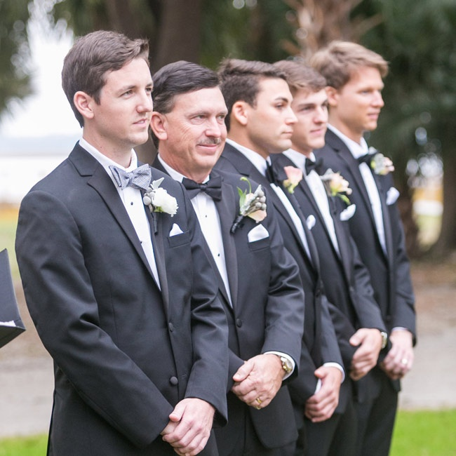 Kyle and his groomsmen looked sharp in tailored black suits, tuxedo shirts and classic bow ties.