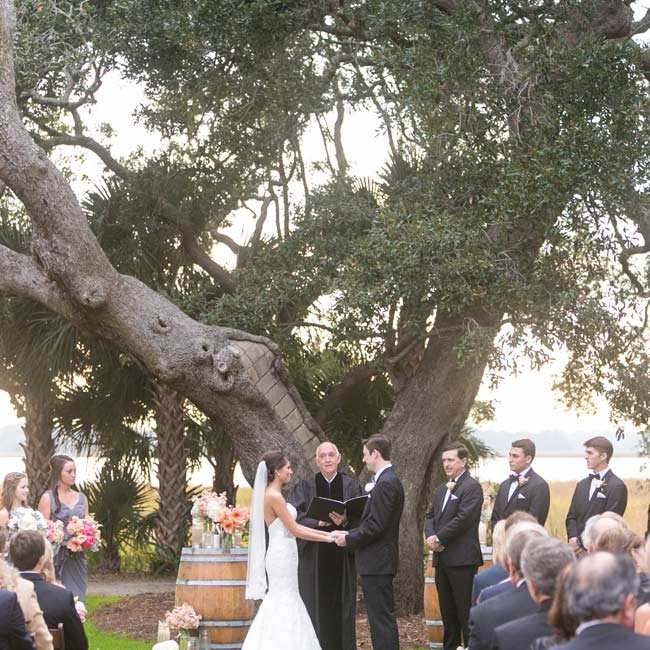 Lauren and Kyle exchanged vows in an outdoor ceremony underneath an old oak tree overlooking the Ashley River.