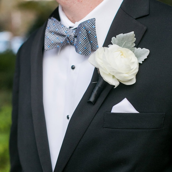 Kyle wore a simple white cabbage rose accented with lamb's ear on his lapel.