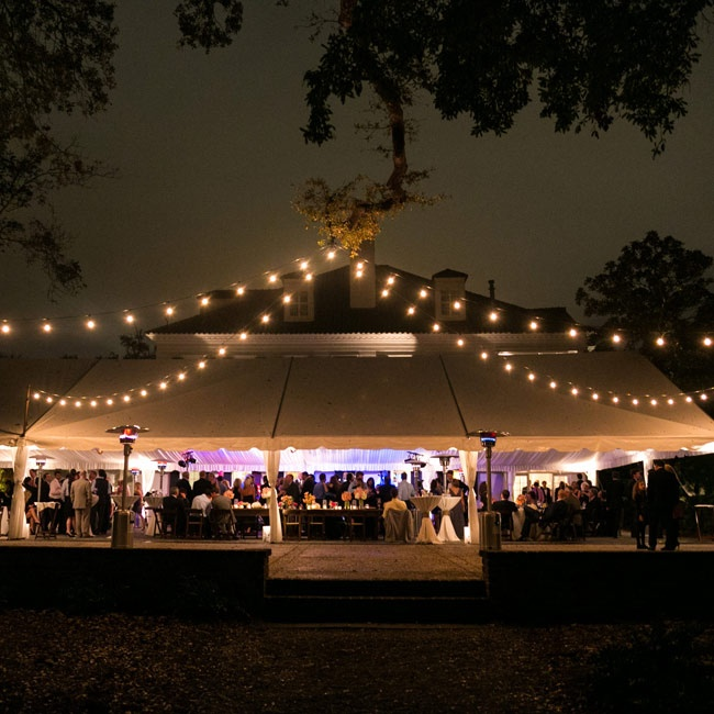 The reception was held under a tent positioned between the river and the Lowndes estate. Bistro lighting and uplighting in fun blues and purples provided plenty of light that kept guests dancing as the sun went down.